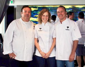 Chef Amber Kaba (center) posing with Australian chefs Peter Gilmore (left) and Neil Perry (right)