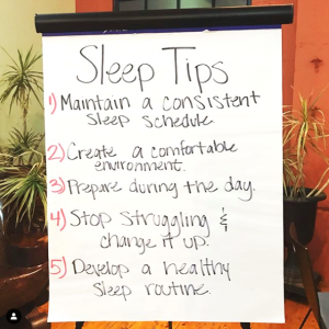"A poster board with writing on it. The text reads: ""Sleep Tips. 1. Maintain a consistent sleep schedule. 2. Create a comfortable environment. 3. Prepare during the day. 4. Stop struggling & change it up. 5. Develop a healthy sleep routine."""